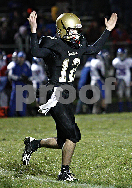 Rob Winner – rwinner@daily-chronicle.com<br /> <br /> Sycamore quarterback Trevor Mathey celebrates after completing a pass for a two point conversion to tie Glenbard South during the second quarter.<br /> <br /> 10/23/2009