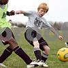 Beck Diefenbach  -  bdiefenbach@daily-chronicle.com<br /> <br /> Adam Millburg during soccer practice at DeKalb High School in DeKalb, Ill., on Thursday April 9, 2009.
