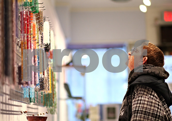 Beck Diefenbach  -  bdiefenbach@daily-chronicle.com<br /> <br /> Judy Jennings, of DeKalb, browses beads at Bliss Beads Studio and Gallery at 161 E. Lincoln Hwy., in DeKalb, Ill., on Friday Feb. 13, 2009. The new store also has classes for glass bead making.