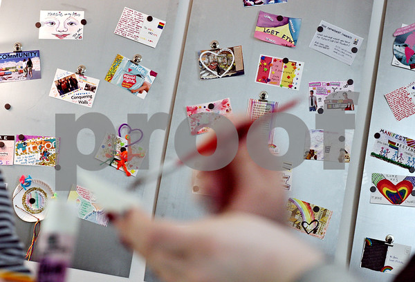 Beck Diefenbach  -  bdiefenbach@daily-chronicle.com<br /> <br /> Postcards litter the wall of the LGBT Resource Center as Northern Illinois University freshman Jen Yesaitis paints her piece of art to be contributed to the display on the NIU campus in DeKalb, Ill., on Wednesday April 1, 2009.