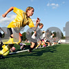 Rob Winner – rwinner@daily-chronicle.com<br /> Drew Moulton, 12, of Sycamore, and her teammates sprint during a recent practice for the Northern Illinois Football Club.<br /> 08/05/2009