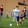 Rob Winner – rwinner@daily-chronicle.com<br /> <br /> Somonauk's Joel Calderon races down the field during Wednesday's match against Indian Creek.<br /> <br /> 10/07/2009