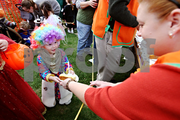 Rob Winner – rwinner@daily-chronicle.com<br /> <br /> 2-year-old Jeremy Kessel of Sycamore receives a piece of cake from Jennifer Diehl as the Sycamore Pumpkin Festival kicked off on Wednesday October 21, 2009.
