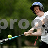 Rob Winner – rwinner@daily-chronicle.com<br /> Cory Bradburn takes batting practice in the backyard of his Hinckley home. Bradburn will be using tennis balls to hit until he has fully recovered from his head injury.<br /> 07/01/2009