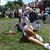 Beck Diefenbach  -  bdiefenbach@daily-chronicle.com<br /> <br /> USA's Christina Kim (bottom), Michelle Wie (top left) and assistant captain Kelly Robbins share a laugh while waiting for teammates to finish the 14th hole during the match against team Europe at the Solheim Cup in Sugar Grove, Ill., on Saturday Aug. 22, 2009. Kim and Wei finished their match 5 up on the 14th hole.