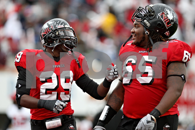 Rob Winner – rwinner@daily-chronicle.com<br /> Jordan Delegal (left) and Jason Onyebuagu head to the locker room at the end of the first half.<br /> 10/03/2009