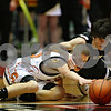 Beck Diefenbach  I  bdiefenbach@daily-chronicle.com<br /> <br /> DeKalb's Patrick Rourke (25) and Sycamore's Luke Johnson (11) leap for a loose ball during the second quarter of the game at the Northern Illinois University Convocation Center in DeKalb, Ill., on Friday Jan. 30, 2009.