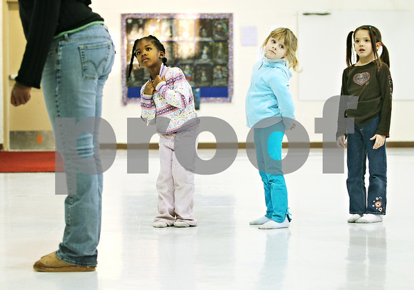 Beck Diefenbach  -  bdiefenbach@daily-chronicle.com<br /> <br /> (From left to right) Kindergarteners Alana Paty, Joanna Smolla and Alaina Dean watch as their dance instructor Jessica Lyons demonstrates their routine during their dance rehearsal after school in Malta, Ill., on Wednesday Jan 21, 2009.