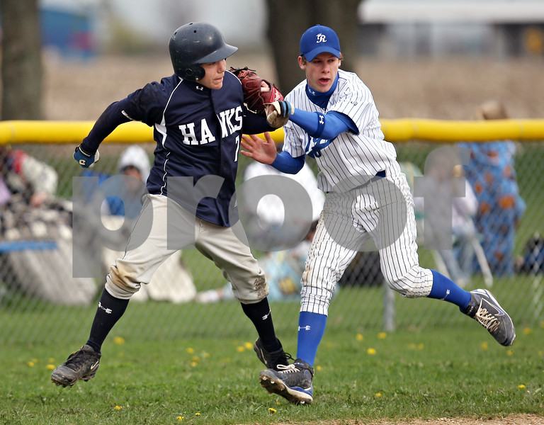 Beck Diefenbach  -  bdiefenbach@daily-chronicle.com<br /> <br /> Hinckley-Big Rock's Colton Craig, right, tags out Hiawatha's (7) after getting stuck in a pickle during the third inning of the game at HBR High School in Hinckley, Ill., on Tuesday April 28, 2009.
