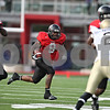 Rob Winner – rwinner@daily-chronicle.com<br /> Me'co Brown carries the ball during the second half.<br /> 09/26/2009
