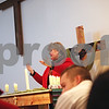 Beck Diefenbach  -  bdiefenbach@daily-chronicle.com<br /> <br /> Pastor Diane Dardon holds a prayer vigil  on the later made of the six crosses which stood outside the Lutheran Campus Ministry Center on the campus of Northern Illinois University in DeKalb, Ill., on Saturday Feb. 14, 2009.