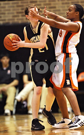 Beck Diefenbach  -  bdiefenbach@daily-chronicle.com<br /> <br /> DeKalb's Michelle Todd (3, right) blocks the view of Sycamore's Kate Binder (21) during the second quarter of the game at DeKalb High School in DeKalb, Ill., on Tuesday Dec. 1, 2009. Sycamore defeated DeKalb 38 to 33.