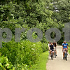 Beck Diefenbach  -  bdiefenbach@daily-chronicle.com<br /> <br /> A group of Sycamore High School seniors ride their bikes down a path behind the North Elementary School in Sycamore, Ill., on Tuesday July 14, 2009