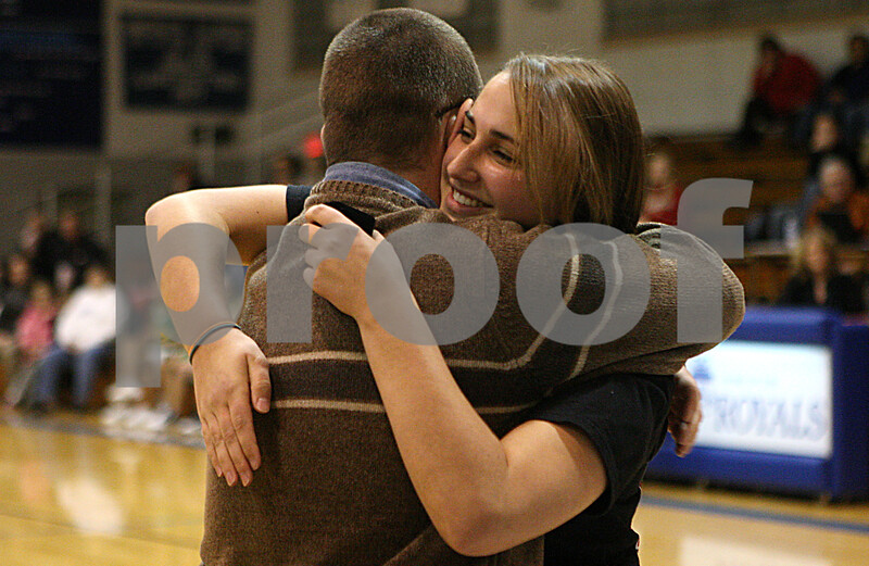 Rob Winner – rwinner@daily-chronicle.com<br /> Hinckley-Big Rock head coach Greg Burks hugs former player Bianca Edmeier during a ceremony recognizing the 2008-2009 IHSA Class 1A State Champions on Saturday December 19, 2009 in Hinckley, Ill.