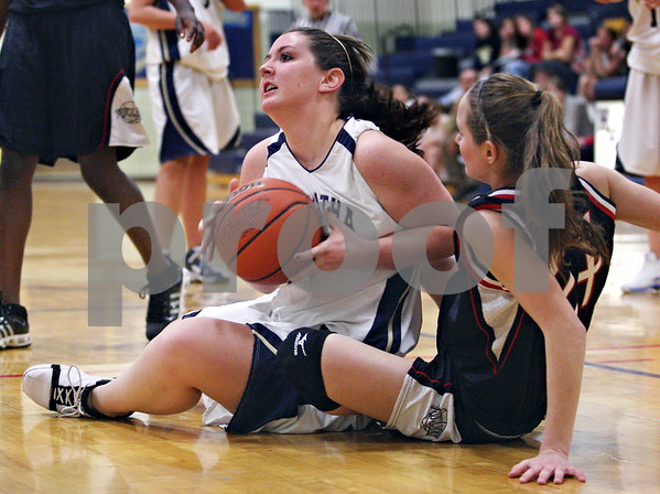 Beck Diefenbach  -  bdiefenbach@daily-chronicle.com<br /> <br /> Hiawatha's Aubrey Leonard (12) recovers a loose ball after struggling with Indian Creek's Jenna Holm (24) during the first quarter of the game at Hiawatha High School in Kirkland, Ill., on Monday Jan. 12, 2008.