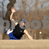 Beck Diefenbach  -  bdiefenbach@daily-chronicle.com<br /> <br /> Hinckley-Big Rock's Jack Paver dives for a ball in center field during practice at HBR High School in Hinckley, Ill., on Monday March 16, 2009.