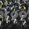 Northern Illinois University graduates move their tassles to the right side of their caps during commencement ceremonies at the Convocation Center on Sunday, December 12, 2009 in Dekalb, IL.  (Marcelle Bright/for the Chronicle)