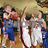 Beck Diefenbach  -  bdiefenbach@daily-chronicle.com<br /> <br /> Hinkcley-Big Rock's Ryan Korth (31) grabs a rebound over Indian Creek's Reece Bend (11) and Mike Wong (12) during the third quarter of the Little 10 consolation game at Somonauk High School in Somonauk, Ill., on Friday Feb. 6, 2009.