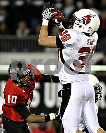 Rob Winner – rwinner@daily-chronicle.com<br /> Ball State safety Alex Knipp intercepts a pass intended for NIU wide receiver Willie Clark (10) during the second quarter. NIU defeated Ball State 26-20 on Thursday night in DeKalb.<br /> 11/12/2009