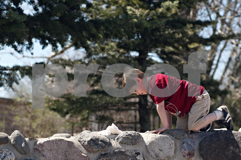 """Beck Diefenbach  -  bdiefenbach@daily-chronicle.com<br /> <br /> Dolan Hereck, 4, climbs a brick bench while having a picnic with his mother Erin, of Sycamore, at the NIU Lagoon on the Northern Illinois University campus in DeKalb on Friday April 17, 2009. """"It's a beautiful day and wanted to get out,"""" Erin Hereck said. It was Dolan's first time at the lagoon."""