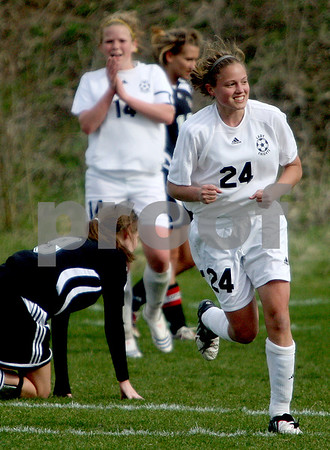 Rob Winner – rwinner@daily-chronicle.com<br /> Kaneland's Emily Heimerdinger reacts and looks to the Knights' bench after her goal in the first half against Indian Creek on Thursday afternoon in Maple Park. Kaneland defeated Indian Creek 2-0.<br /> 04/23/2009