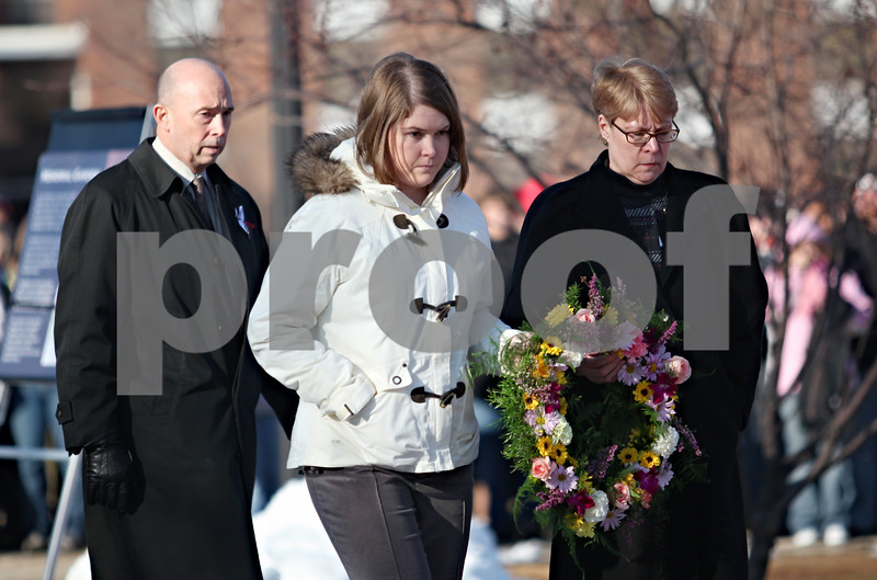 Beck Diefenbach  -  bdiefenbach@daily-chronicle.com<br /> <br /> Mourners present one of the memorial wreaths outside Cole Hall on the campus of Northern Illinois University in DeKalb, Ill., on Saturday Feb. 14, 2009.