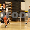 Beck Diefenbach  -  bdiefenbach@daily-chronicle.com<br /> <br /> Sycamore's Joe Strack, right, follows Harlan Johnson during practice at Sycamore High School in Sycamore, Ill., on Monday Jan. 19, 2008. Strack and Johnson are first cousins.