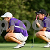 Beck Diefenbach  -  bdiefenbach@daily-chronicle.com<br /> <br /> Hampshire's Connie (left) and Taylor Ellett line up their puts during their match against Genoa-Kingston High school at Oak Club of Genoa in Genoa, Ill., on Wednesday Sept. 23, 2009.