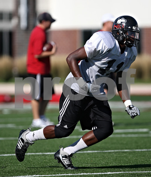 Beck Diefenbach  -  bdiefenbach@daily-chronicle.com<br /> <br /> Wide receiver Marcus Lewis (11) during practice at Huskie Stadium of Northern Illinois University in DeKalb, Ill., on Tuesday Sept. 1, 2009.