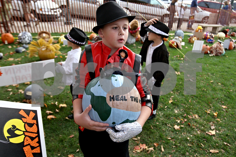 Rob Winner – rwinner@daily-chronicle.com<br /> <br /> Shayne Zientek, 9, of Sycamore looks for the area where his pumpkin entry is to be placed during the first day of the Sycamore Pumpkin Festival.<br /> <br /> 10/21/2009