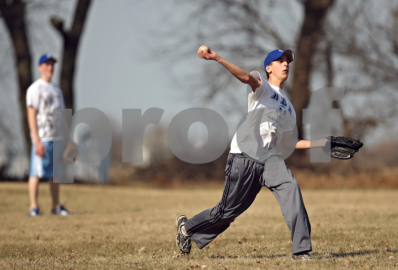 Beck Diefenbach  -  bdiefenbach@daily-chronicle.com<br /> <br /> Hinckley-Big Rock's Brandon Dillenbeck throws to the first place during practice at HBR High School in Hinckley, Ill., on Monday March 16, 2009.
