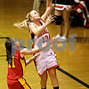 Beck Diefenbach  -  bdiefenbach@daily-chronicle.com<br /> <br /> DeKalb's Kay Smith (13, center) shoots the ball for two points during the third quarter of the game against Batavia at DeKalb High School in DeKalb, Ill., on Tuesday Dec. 8, 2009.
