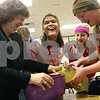 Beck Diefenbach  -  bdiefenbach@daily-chronicle.com<br /> <br /> Vision teacher Donna O'Hagan, left, and 6th graders Mickey Kmetz, right, and Stephannie Baccay, who is blind, can't keep a straight face as Stephannie attempts to pour herself a drink during the Braille Club meeting at Sycamore Middle School in Sycamore, Ill., on Thursday Jan. 22, 2008. Students were celebrating Louis Braille's 200th birthday.
