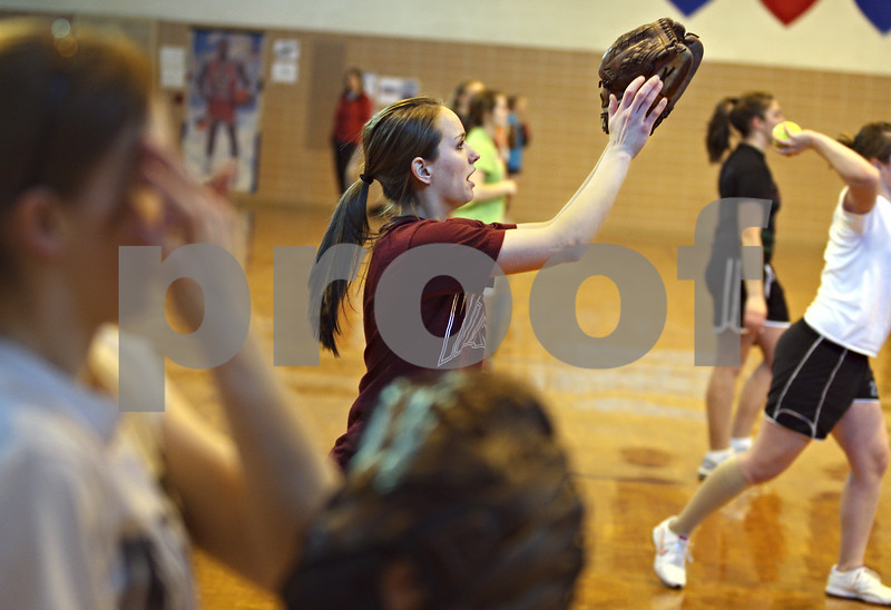 Beck Diefenbach – bdiefenbach@daily-chronicle.com<br /> <br /> Indian Creek's Jenna Holm catches the ball during practice at the Indian Creek Middle School gymnasium in Waterman, Ill., on Wednesday March 11, 2009.