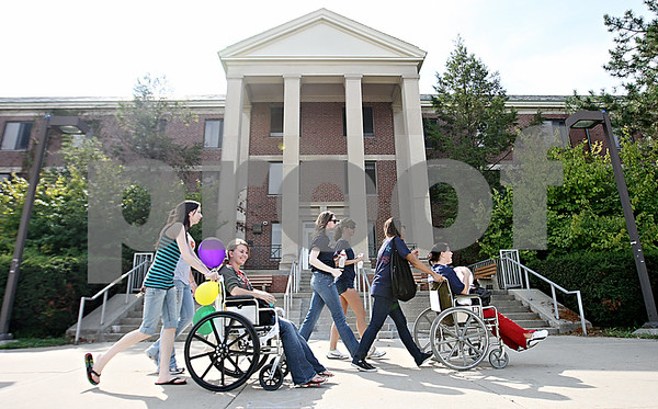 Rob Winner –  rwinner@daily-chronicle.com<br /> Participants of RAMP's annual Wheel-A-Thon pass by Neptune Hall on Saturday in DeKalb.<br /> 09/19/2009