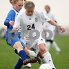 Beck Diefenbach  -  bdiefenbach@daily-chronicle.com<br /> <br /> Hinckley-Big Rock's Hannah Hildebrand (25) attempts to swipe the ball from Kaneland's Emily Heimerdinger (24) during the second half of the game at Kaneland High School in Maple Park, Ill., on Wednesday April 29, 2009.