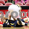 Beck Diefenbach – bdiefenbach@daily-chronicle.com<br /> <br /> Toledo Naama Shafir (4) looks to pass the ball after colliding with Northern Illinois guard Jessie Wilcox (10) during the first half of the game at the Convocation Center in DeKalb, Ill., on Tuesday Feb. 24, 2009.