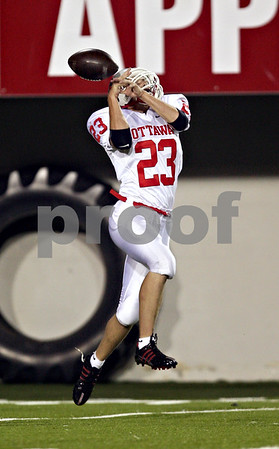Beck Diefenbach  -  bdiefenbach@daily-chronicle.com<br /> <br /> Ottawa's Taylor Ostrowski (23) can't hold on to a punt return ball during the first quarter of the game against DeKalb High School at Huskie Stadium of Northern Illinois University in DeKalb, Ill., on Friday Aug. 28, 2009.