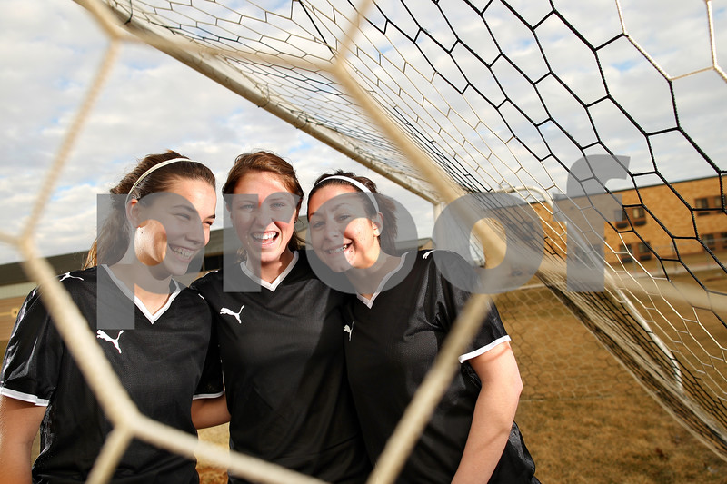 Beck Diefenbach – bdiefenbach@daily-chronicle.com<br /> <br /> Sycamore High School's, from left, Sara Cervenka, Karissa Miller and Nici Newquist.