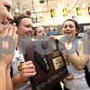 Chronicle photo KATE WEBER<br /> Members of the Sycamore volleyball team celebrate their IHSA SuperSectional victory Monday night against Metamora in Galesburg.
