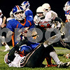 Rob Winner – rwinner@daily-chronicle.com<br /> <br /> Genoa-Kingston quarterback Craig Billington is sacked for a loss of five yards by Stillman Valley defensive end Kody Harriott during the second quarter of Friday night's game.<br /> <br /> 10/16/2009