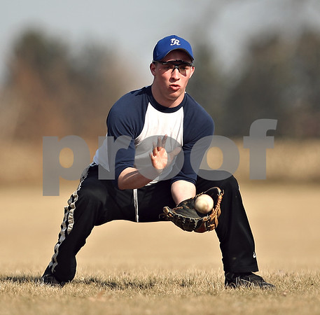 Beck Diefenbach  -  bdiefenbach@daily-chronicle.com<br /> <br /> Hinckley-Big Rock's Ryan Michaels catches a ground ball during practice at HBR High School in Hinckley, Ill., on Monday March 16, 2009.