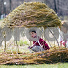 "Beck Diefenbach  -  bdiefenbach@daily-chronicle.com<br /> <br /> Dolan Hereck, 4, explores the inside of a hut of unknown origin while his mother Erin, of Sycamore, watches during a stroll around the NIU Lagoon on the Northern Illinois University campus in DeKalb on Friday April 17, 2009. ""It's a beautiful day and wanted to get out,"" Erin Hereck said. It was Dolan's first time at the lagoon."