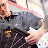 Beck Diefenbach  -  bdiefenbach@daily-chronicle.com<br /> <br /> Bike mechanic Russ Stewart installs a tire onto a wheel at North Central Cyclery in DeKalb, Ill., on Thursday March 27, 2009.