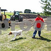 Rob Winner – rwinner@daily-chronicle.com<br /> Volunteer Hardik Shah walks Shadow outside near the TAILS Humane Society in DeKalb. Construction of a new building has begun near the property and TAILS will be expanding to the new site.<br /> 08/13/2009