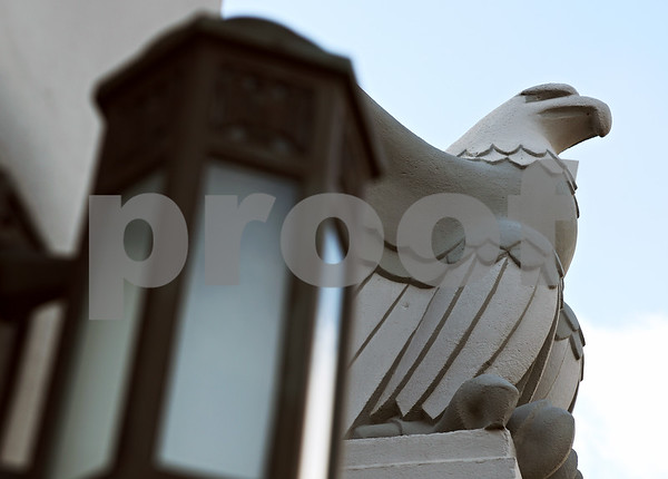 Beck Diefenbach – bdiefenbach@daily-chronicle.com<br /> <br /> An eagle sits by the entrance of the Sycamore Armory in Sycamore, Ill., on Wednesday March 11, 2009.