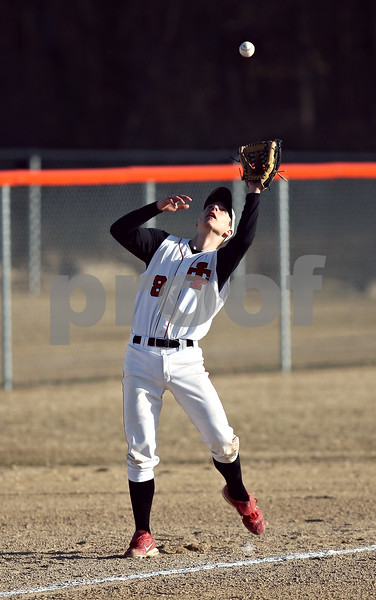 Beck Diefenbach  -  bdiefenbach@daily-chronicle.com<br /> <br /> Indian Creek's Steven Boris (8) catches a pop fly for an out during the bottom of the fourth inning against Genoa Kingston High School at GK High School in Genoa, Ill., on Wednesday March 18, 2009.
