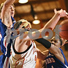 Beck Diefenbach  -  bdiefenbach@daily-chronicle.com<br /> <br /> DeKalb's Jordan Threloff (42) tries to grab the rebound over Glenbard South's Sam Mitchell (24) during the first quarter of the game at DeKalb High School in DeKalb, Ill., on Friday Feb. 13, 2009.