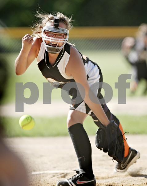 Beck Diefenbach  -  bdiefenbach@daily-chronicle.com<br /> <br /> DeKalb Hurricane's pitcher Kate Dellig (75) throws the ball during a 10-under game against the Cary Crush during Storm Dayz in Sycamore, Ill., on Friday June 26, 2009.