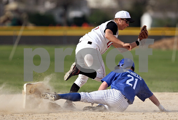 Beck Diefenbach  -  bdiefenbach@daily-chronicle.com<br /> <br /> Hinckley-Big Rock's Ryan Michels (21) nocks over second base and is tagged out by Indian Creek's Reece Bend (11) during the fourth inning of the game at Indian Creek in Shabbona, Ill., on Monday May 4, 2009.